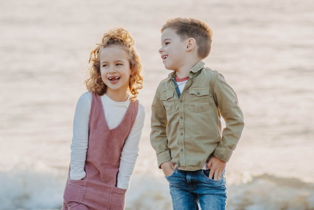 two children standing out side for a picture
